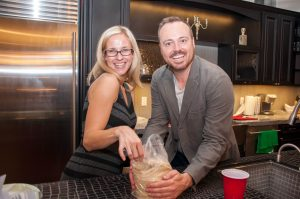 Aquabrass's Rachel Damron and Central Arizona Supply's Jeremy Smith in the kitchen at Graffiti Glam. Graffiti Glam attendees. ©Jasmine Christine Photography.